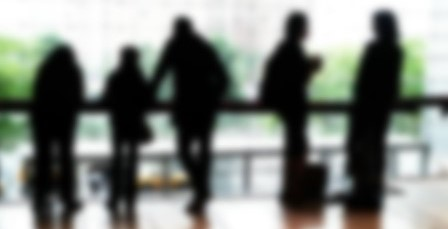 Silhouette Of Five De-focused People Standing In Different Poses, Reflecting In The Floor